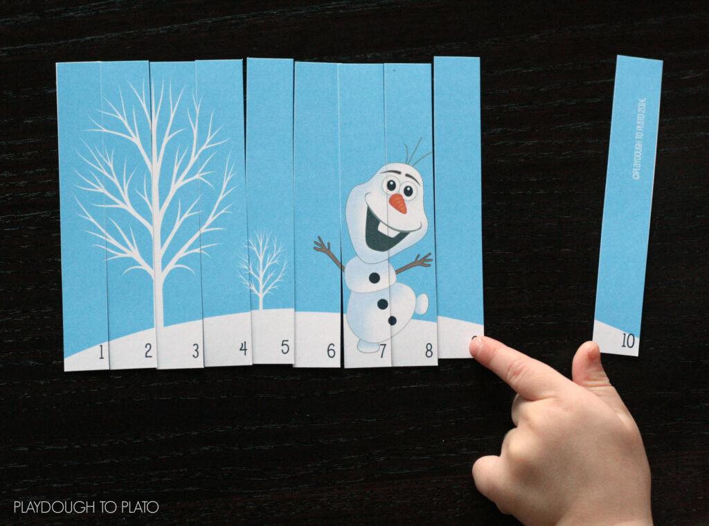 Fun math center or busy bag!! Frozen puzzles.