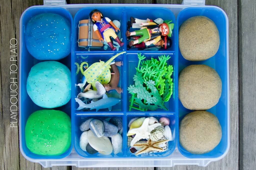 Awesome pirate themed playdough kit. Easy homemade sand and ocean playdough plus fun extras.