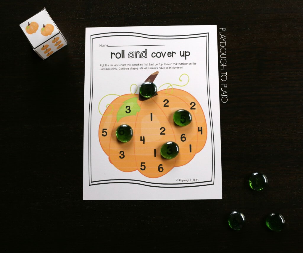 Fun number game for kids. Roll the pumpkin die and cover the number. So simple and fun!