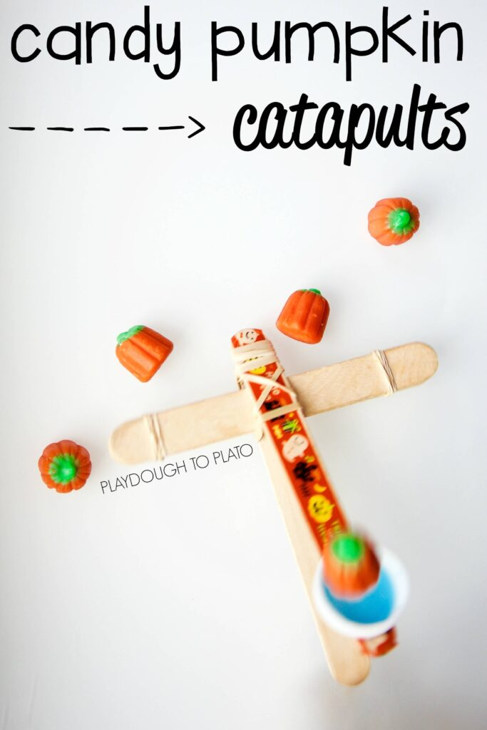 Super fun STEM project for Halloween! Make candy pumpkin catapults.