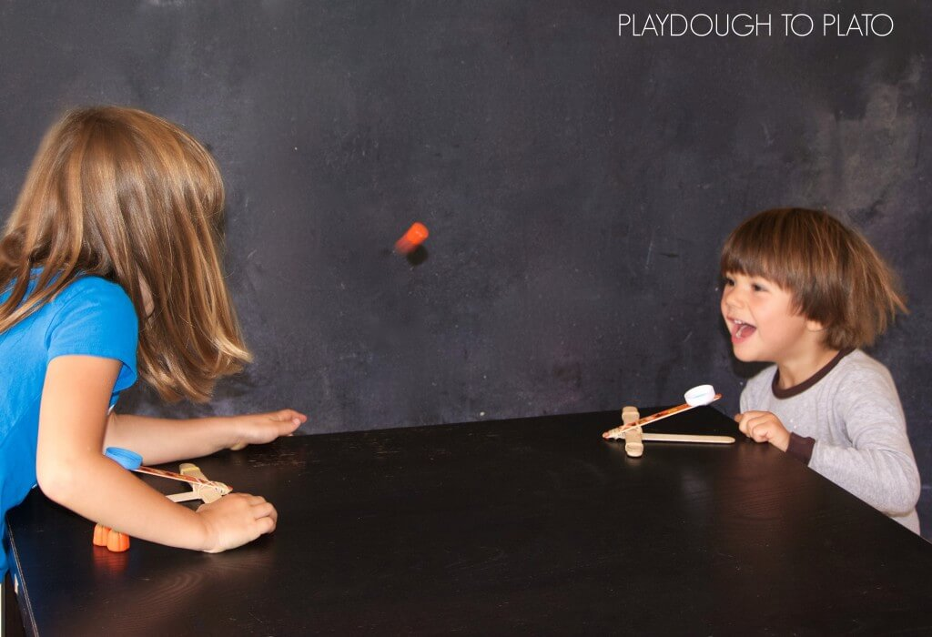Super fun candy pumpkin catapults. These would be a perfect kids science activity for Halloween.