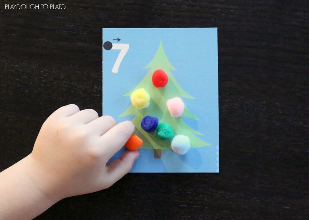 Free Christmas tree counting cards for kids! What a fun way to practice fine motor skills, counting and number writing.