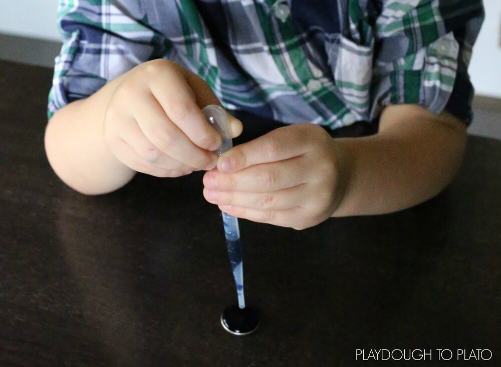 Simple kids' science experiment! How many drops will fit on the coin